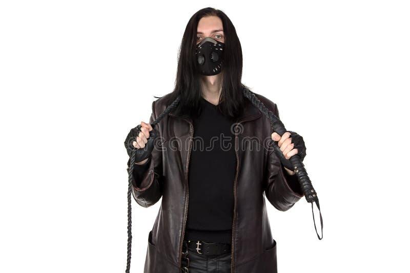 年轻人的图象有鞭子的在面具 库存图片