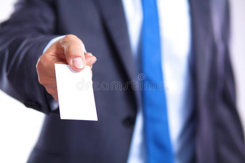 人的手演艺界卡片-特写镜头在灰色背景射击了 免版税库存图片