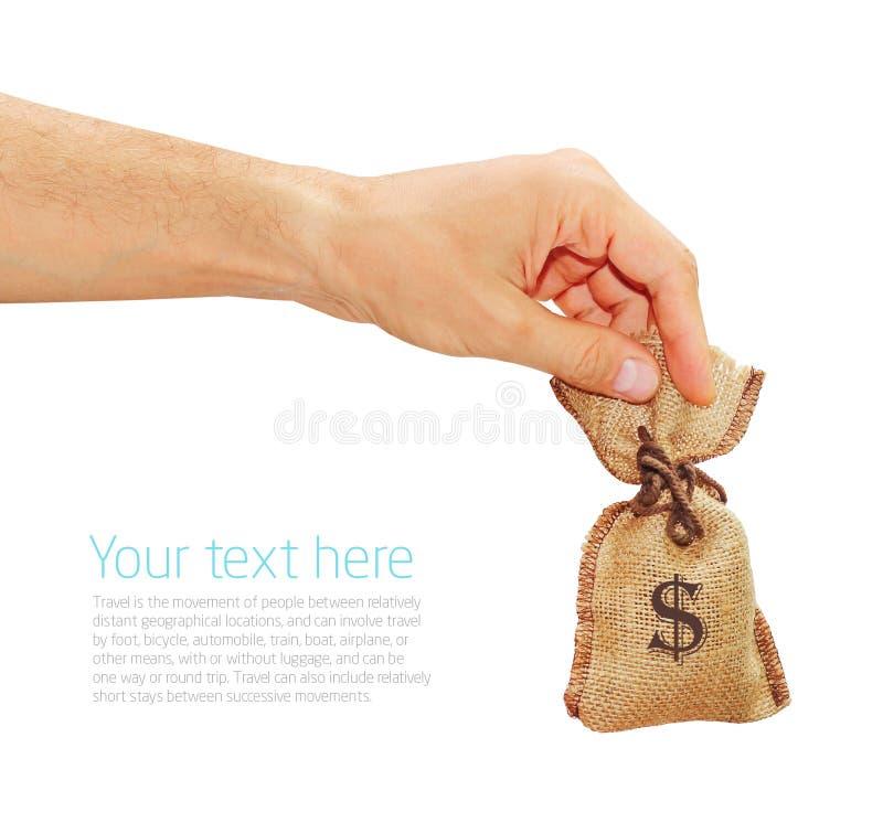 人的手给与美元的袋子 库存照片