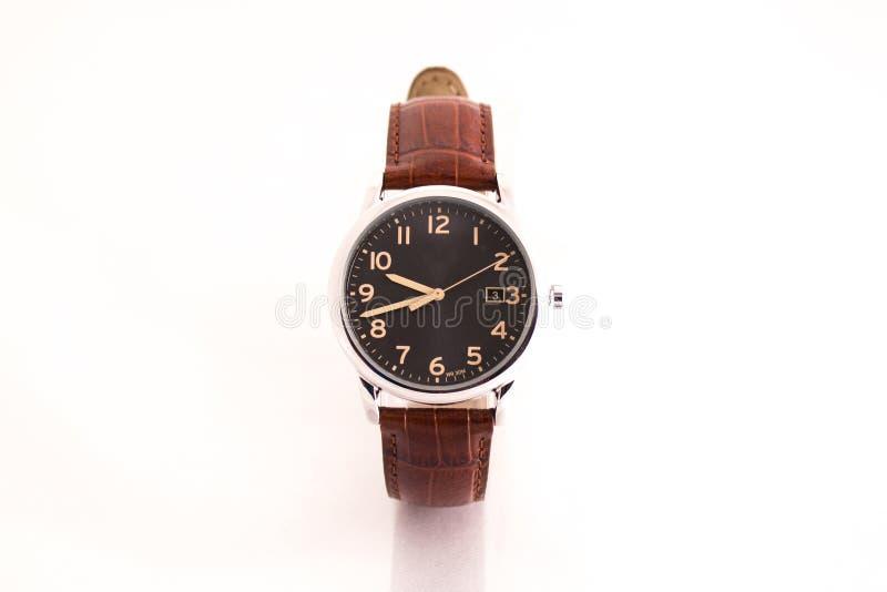 人的棕色皮革手表 免版税库存照片
