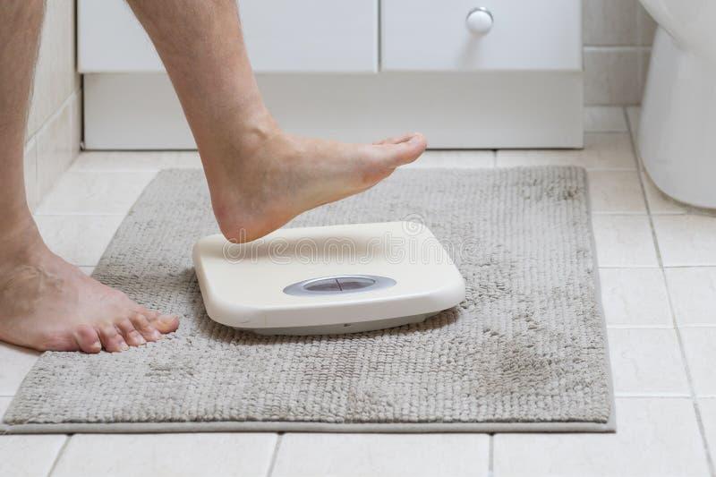 人的脚的播种的图象跨步称标度 库存照片