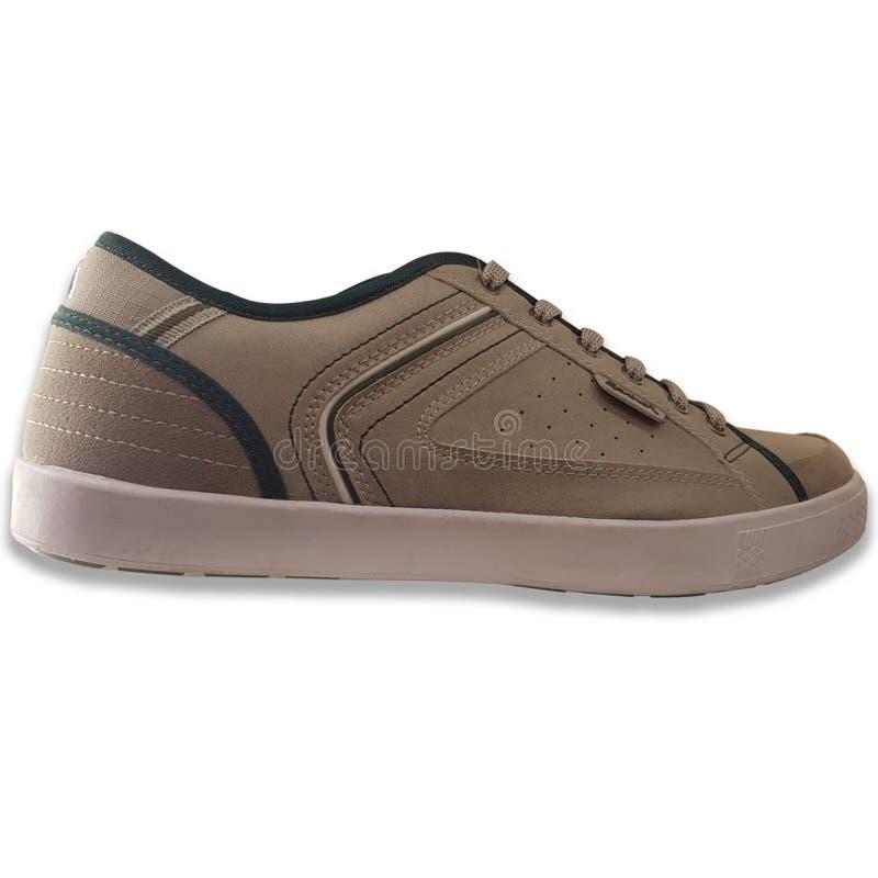 人的运动鞋在布朗颜色 免版税库存图片