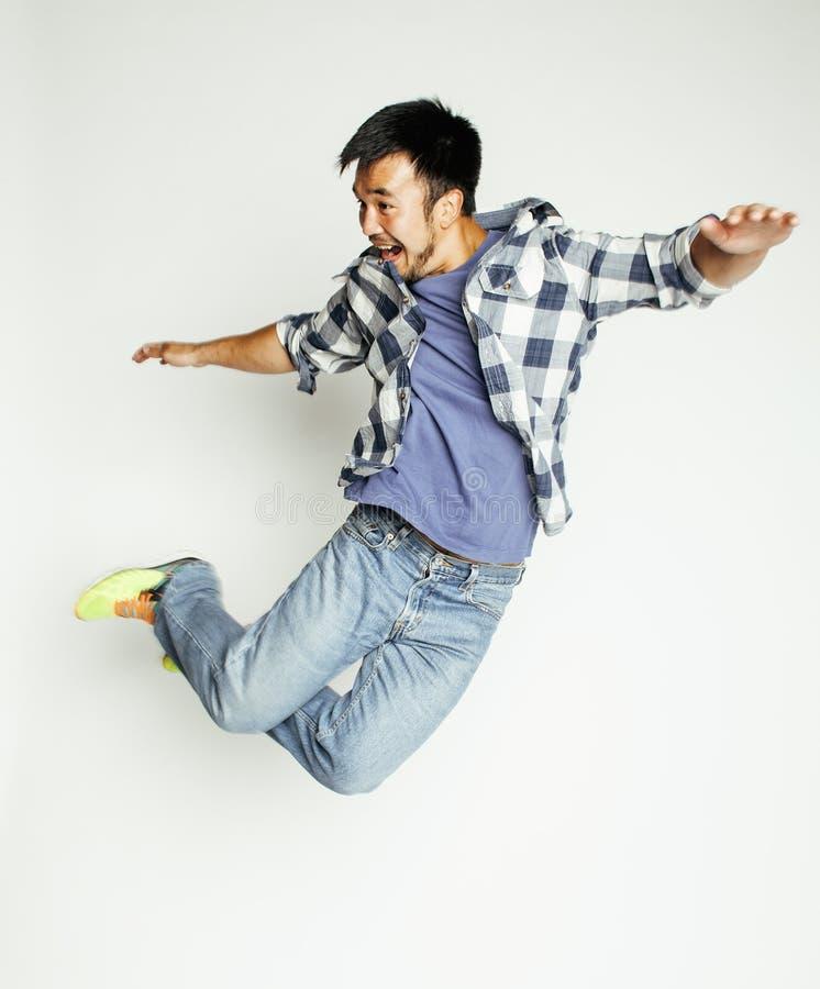 年轻人相当亚洲人跳跃快乐反对白色背景,生活方式人概念 库存图片
