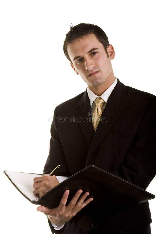 人笔记本诉讼文字年轻人 免版税库存照片