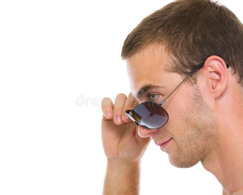 人纵向新配置文件的太阳镜 免版税库存照片