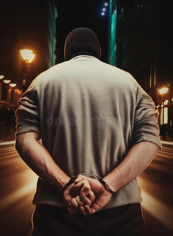 人被拘捕作为他的罪行结果 免版税库存图片
