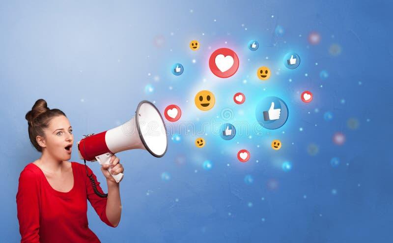 人讲话在扩音器与社会媒介概念 库存照片