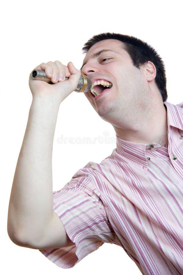 人话筒唱歌年轻人 免版税库存图片