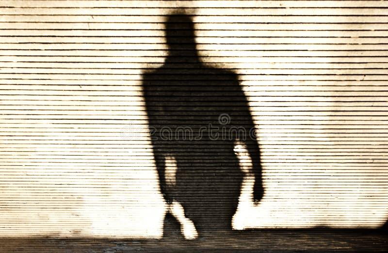 人走的模糊的阴影 库存照片