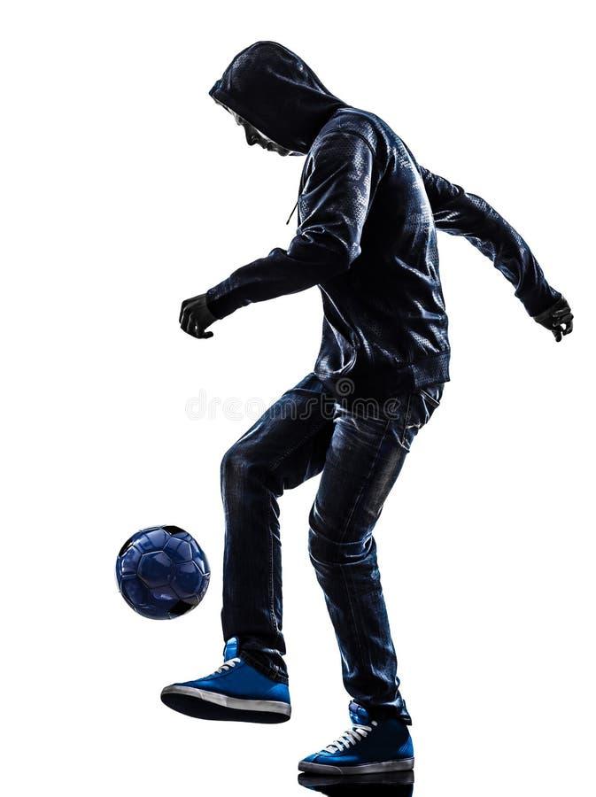 年轻人足球自由式球员剪影 免版税库存图片