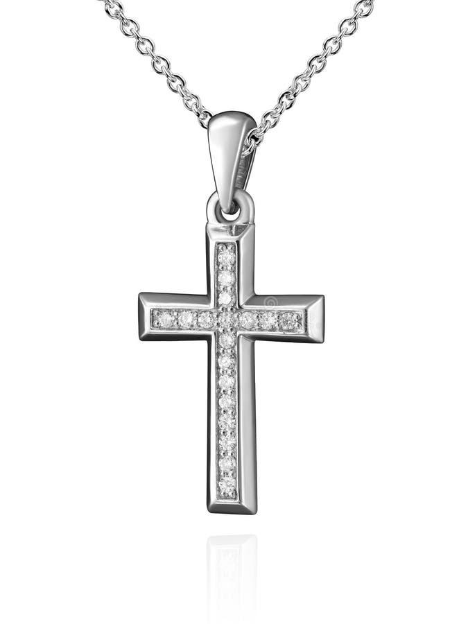 人造白金与在白色隔绝的金刚石的十字架垂饰 免版税库存图片