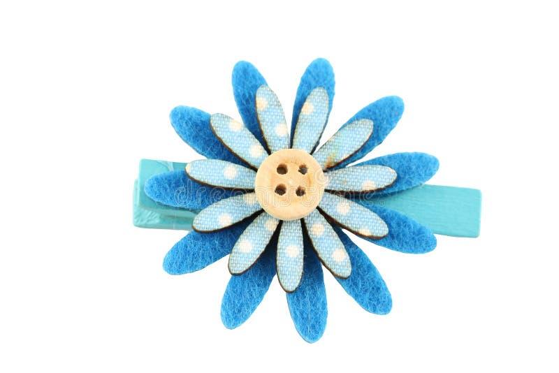 人造花簪子蓝色在白色隔绝的 库存图片