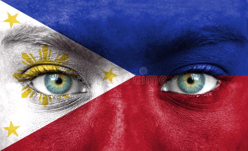 人面绘与菲律宾旗子  免版税库存照片