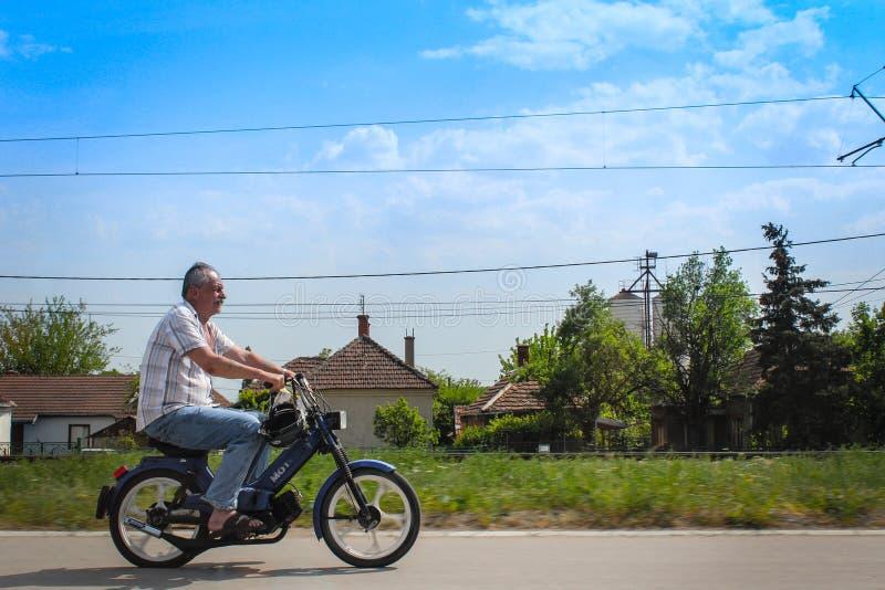 人骑马摩托车 库存图片