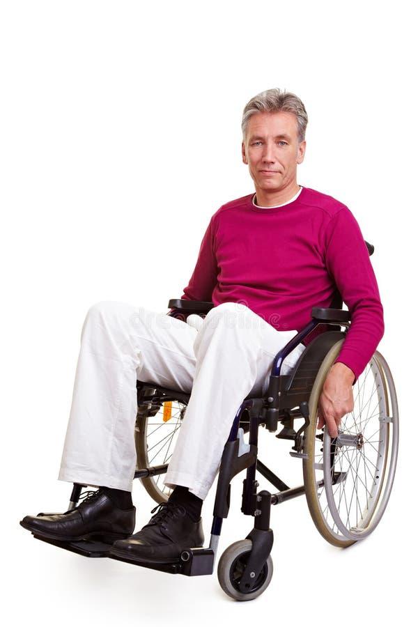 人高级坐的轮椅 库存图片