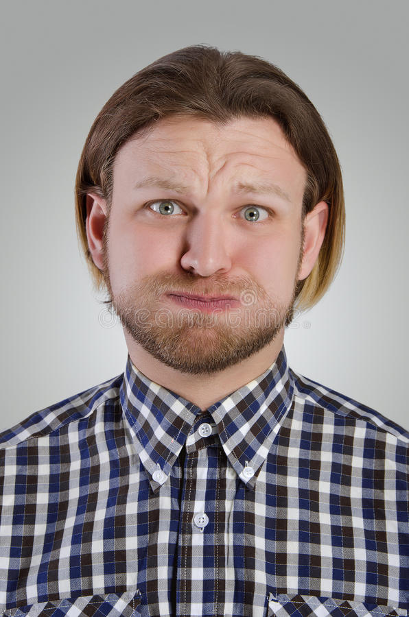 年轻人鬼脸 免版税图库摄影