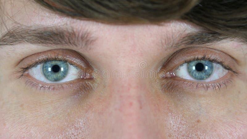人,关闭的眨眼睛眼睛  库存图片