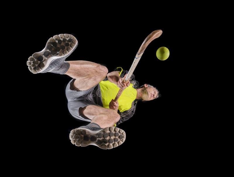 人, 48岁,打曲棍球 免版税图库摄影
