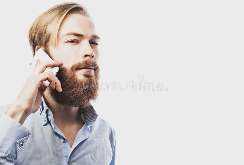 人移动电话联系的年轻人 免版税图库摄影