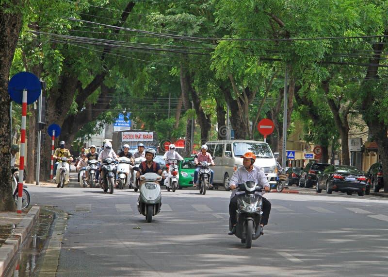 人们在摩托车乘坐 库存照片
