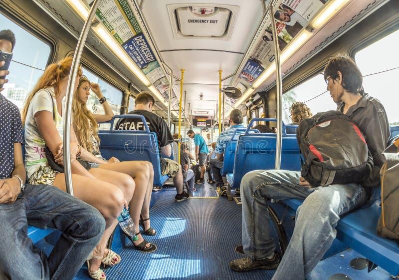 人们在街市地铁公共汽车上在迈阿密,美国 图库摄影