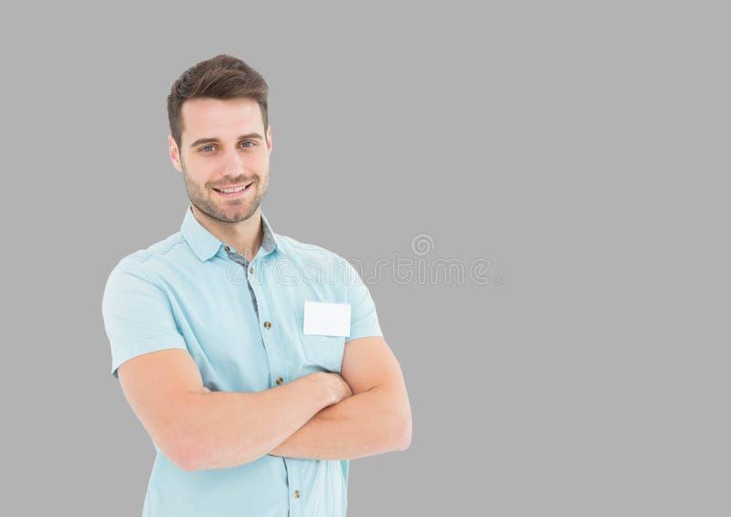 人画象有被交叉的双臂的有灰色背景 免版税库存照片