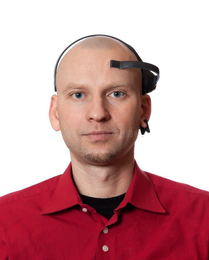 年轻人画象有EEG (脑波记录仪)耳机的 免版税图库摄影