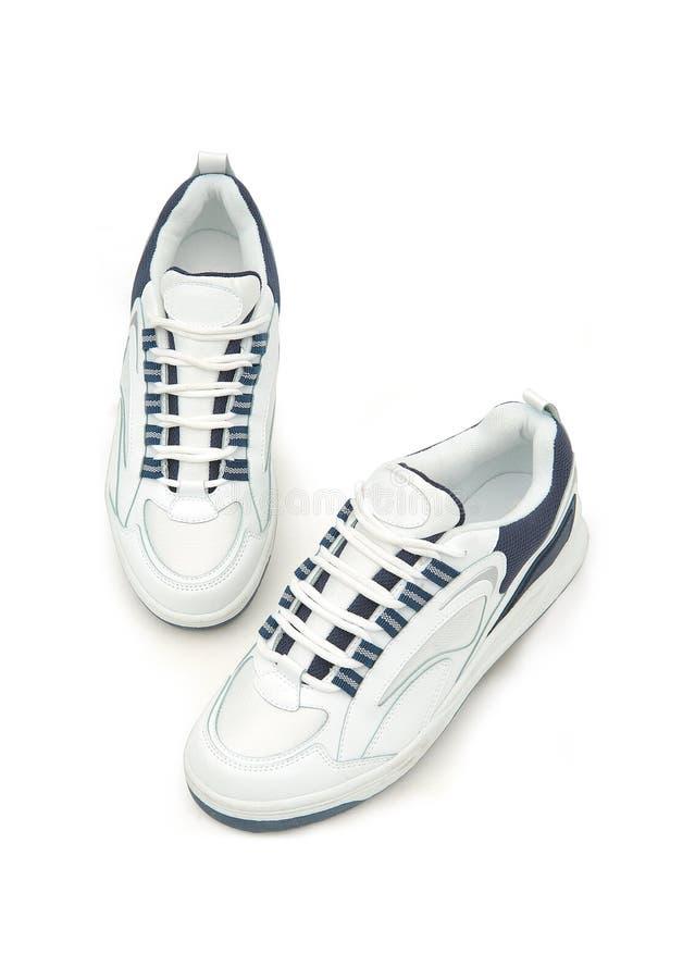 人` s体育鞋子 对穿上鞋子体育运动 Stil生活射击 免版税库存照片