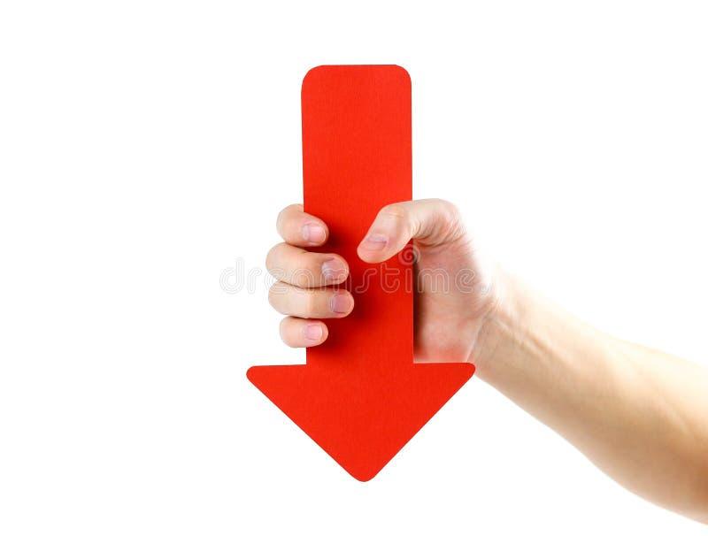 人` s手拿着一个大红色箭头 关闭 隔绝在wh 免版税库存照片