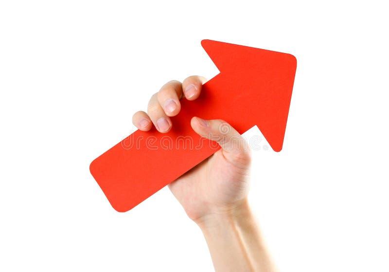 人` s手拿着一个大红色箭头 关闭 隔绝在wh 免版税库存图片