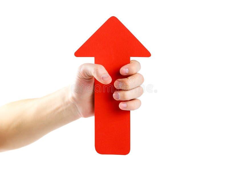 人` s手拿着一个大红色箭头 关闭 隔绝在wh 库存照片