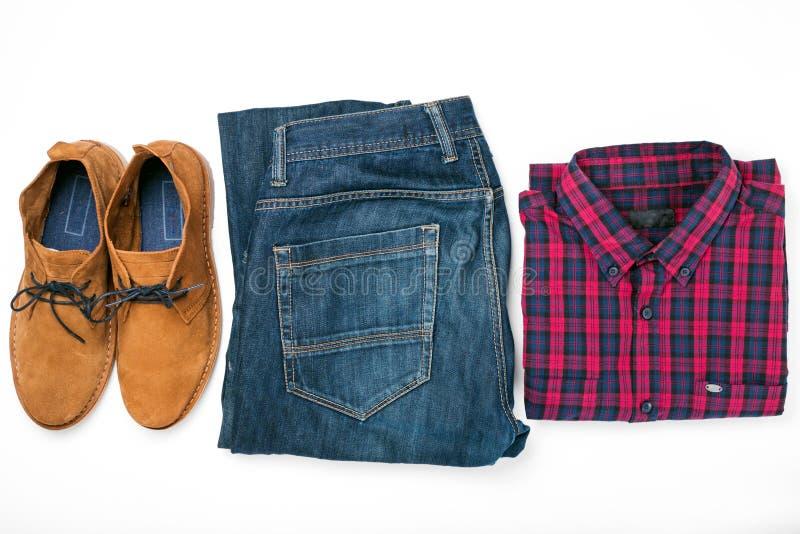 人` s给与衬衣、牛仔裤和鞋子的拼贴画穿衣 库存照片