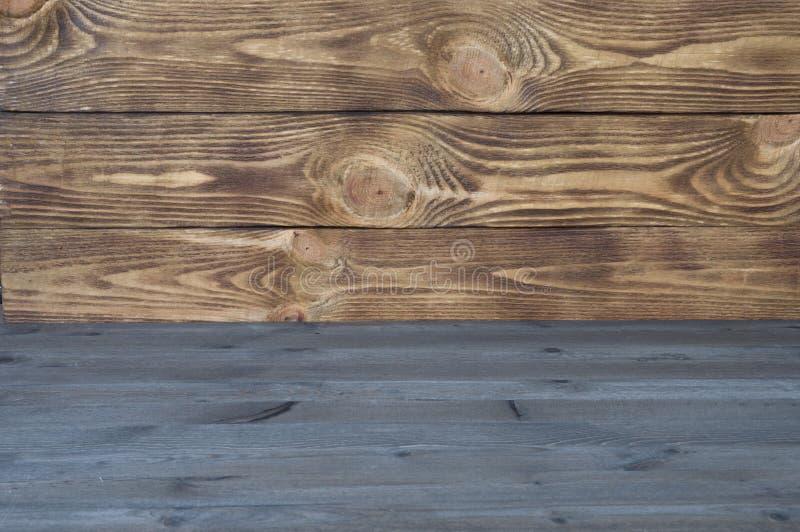 从两种类水平的纹理板的色的木背景  免版税库存图片