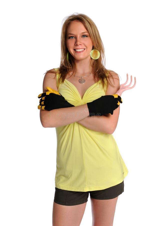 从事园艺的手套妇女 库存照片