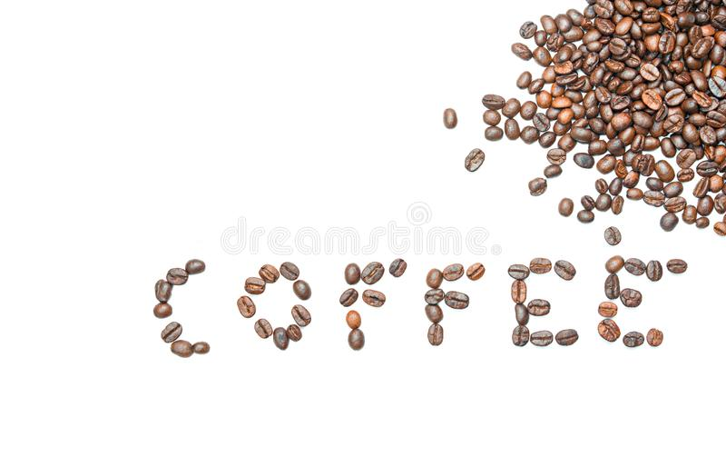从咖啡豆的词咖啡与在被隔绝的白色背景的拷贝空间 库存图片