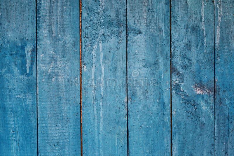 从委员会的蓝色木背景 免版税库存图片