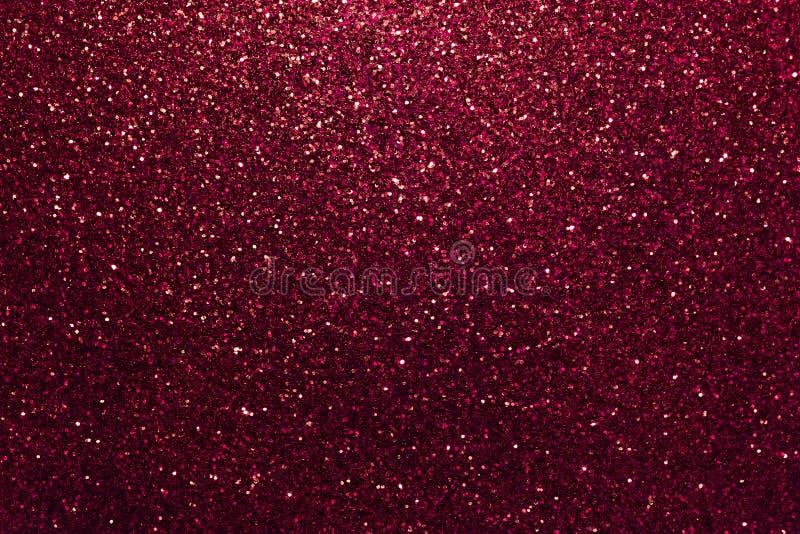 从小衣服饰物之小金属片的深红闪耀的背景,特写镜头 精采背景 库存图片