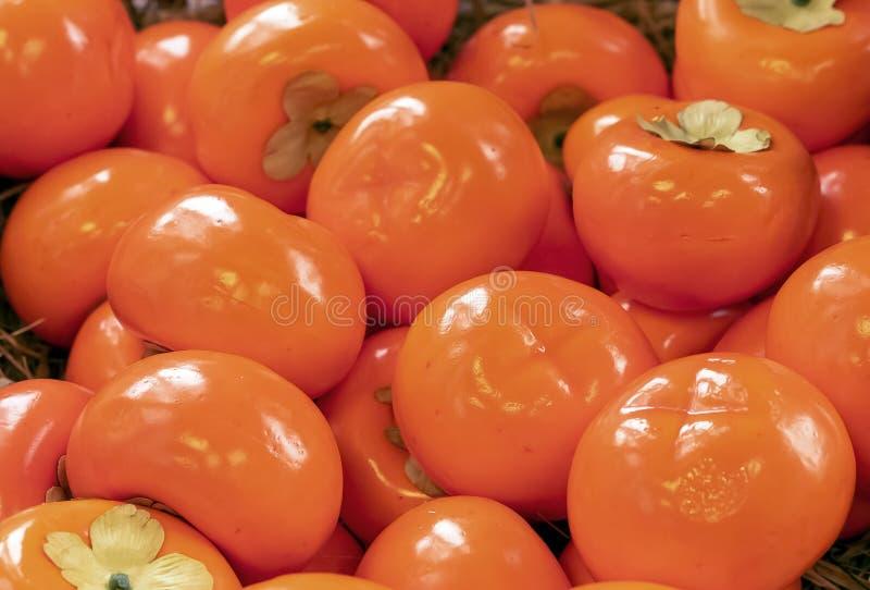 从很大数量的橙色柿子的背景 图库摄影