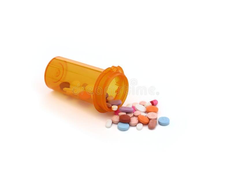 从微量的溢出的药片 免版税库存图片