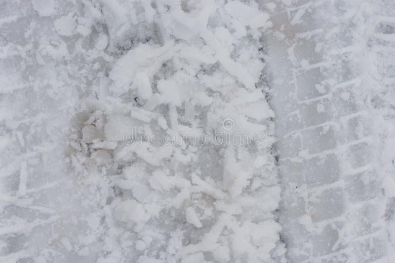 从把引入的轨道雪 close snow texture up white 免版税图库摄影