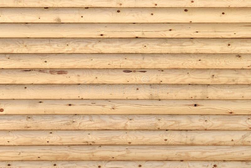 从日志的木墙壁作为背景纹理地板 免版税库存照片