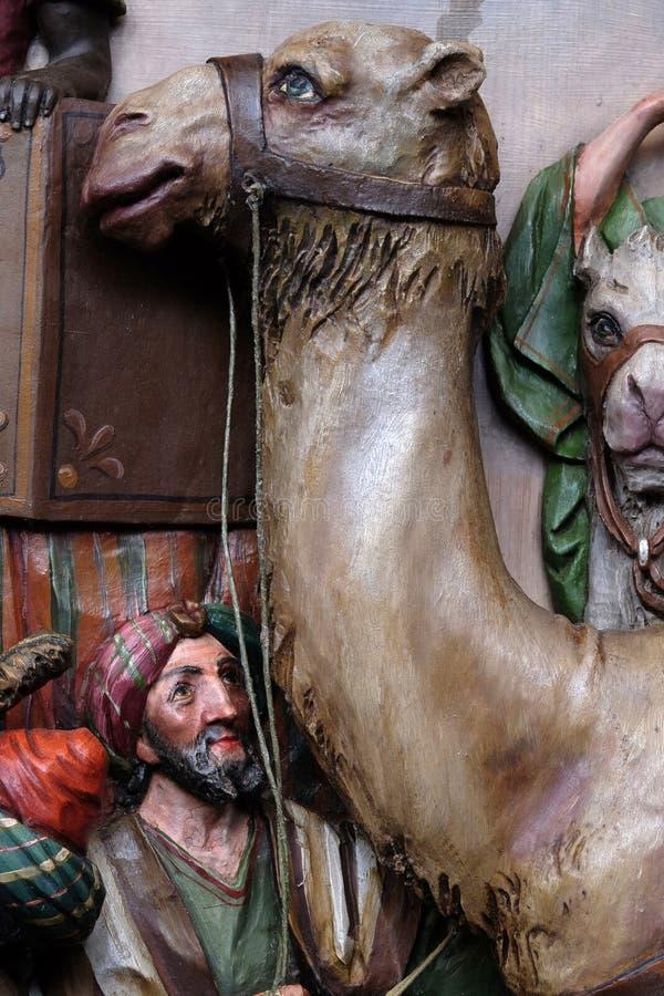 从来崇拜新出生的耶稣圣经的国王的伴游的字符 库存照片