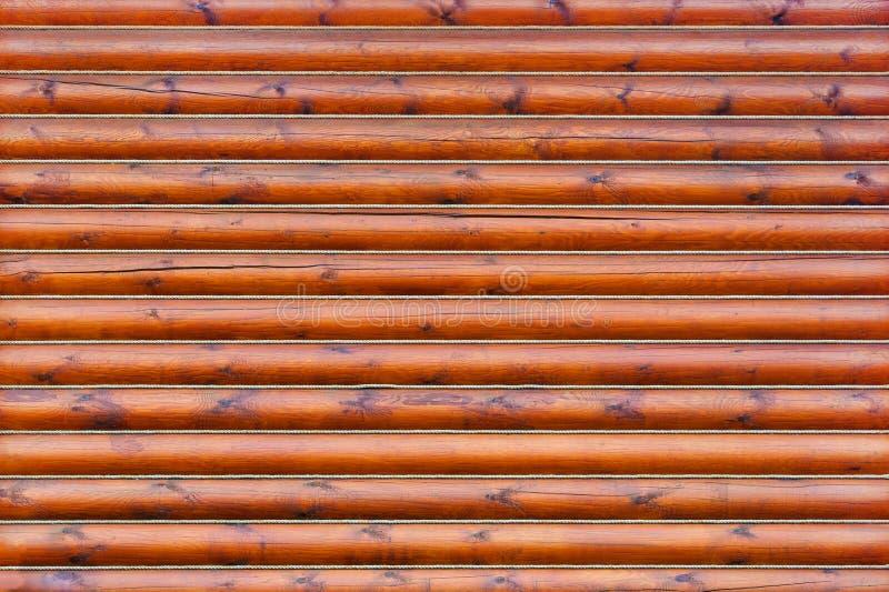 从水平的日志的木墙壁作为纹理,背景 免版税图库摄影