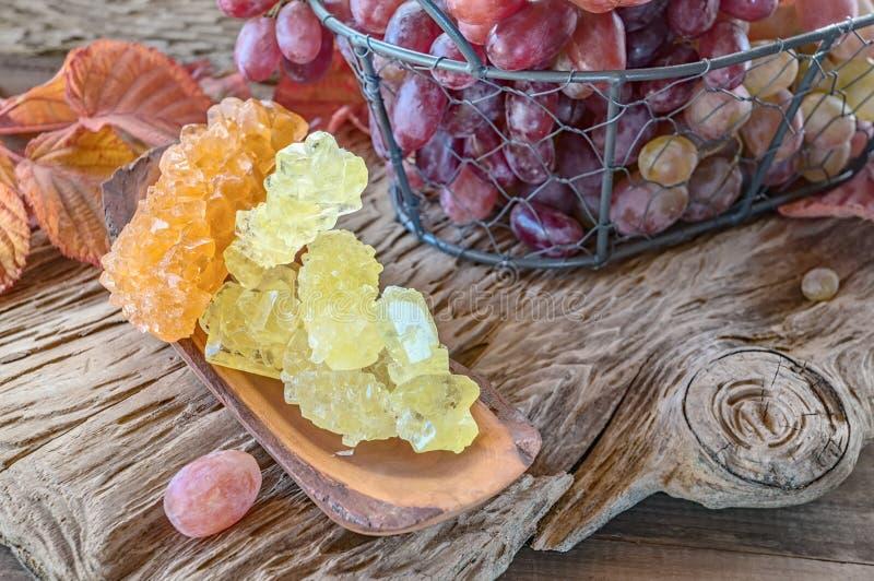 从汁液的干水晶葡萄糖 糖替补 免版税图库摄影