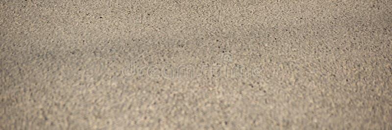 从沥青的长的水平的背景是宏观的 免版税图库摄影