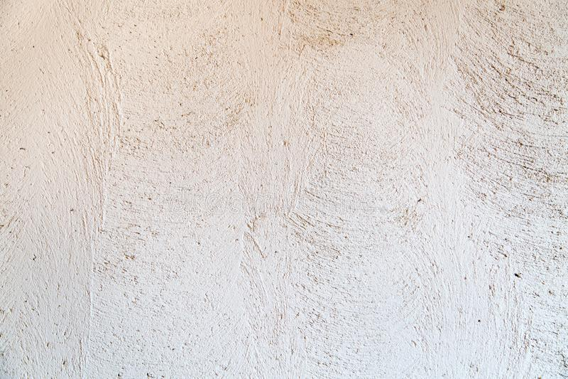 从灰色涂灰泥的墙壁概略的结束的背景 免版税库存照片