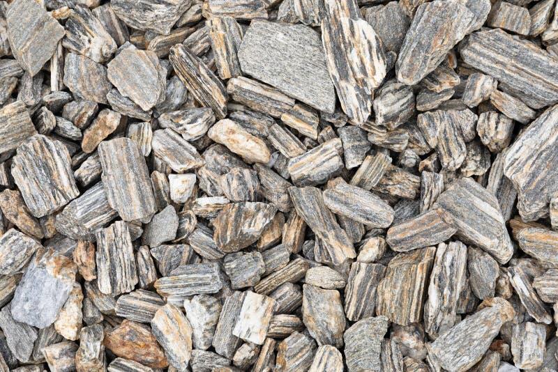 从灰色装饰石头的背景 免版税图库摄影