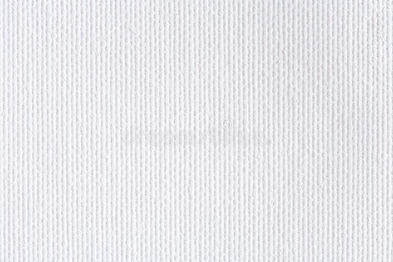 从白色粗糙的帆布纹理的背景 库存图片