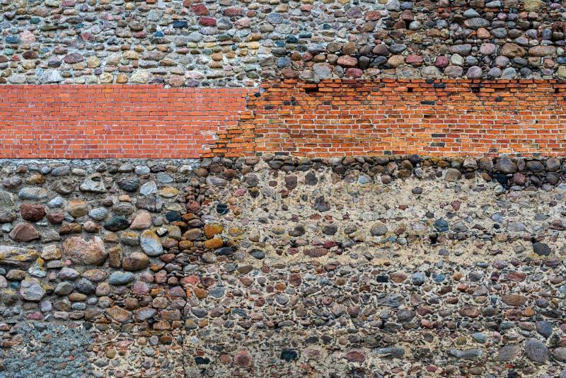 从石头和砖的织地不很细墙壁背景 免版税库存图片