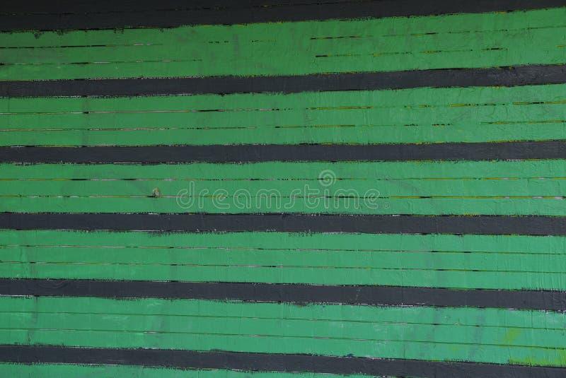 从砖墙的绿色黑镶边石纹理 库存图片